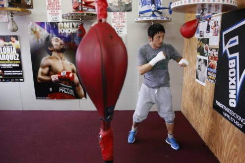 Two-time Olympic gold medalist and three-time world amateur boxing champion Zou of China works out on the speed bag at Wild Card Boxing Club while preparing for his upcoming professional boxing debut, in Los Angeles.